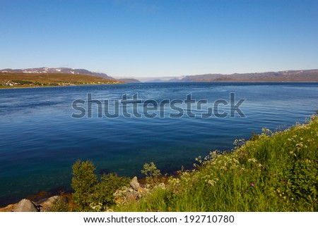 Beautiful panoramic view on mountains and fjord in Norway