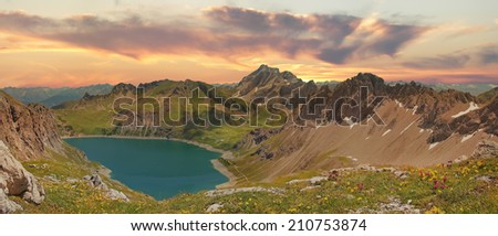 Beautiful panoramic view to lunersee and austrian alps, sunset scenery - stock photo