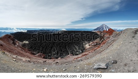 Beautiful panoramic volcanic landscape of active volcano of Kamchatka Peninsula: view of crater Avachinsky Volcano on background scenic cone Koryak Volcano on a sunny day. Russia, Far East, Kamchatka. - stock photo