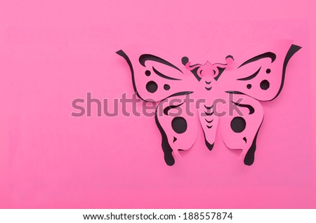 Beautiful paper butterfly on pink background - stock photo