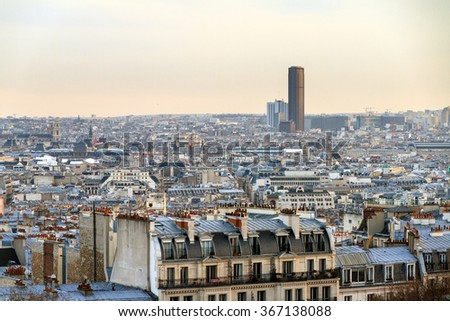 Beautiful Paris afternoon cityscape seen from Montmartre with the tour Montparnasse skyscraper - stock photo