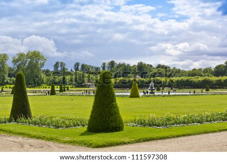 Beautiful park with a fountain in the ancient Fontainebleau palace. Palace of Fontainebleau - one of largest royal chateaux in France (55 km from Paris), UNESCO World Heritage Site. - stock photo