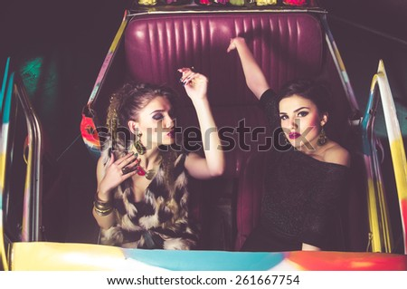 beautiful party girls in a car - stock photo