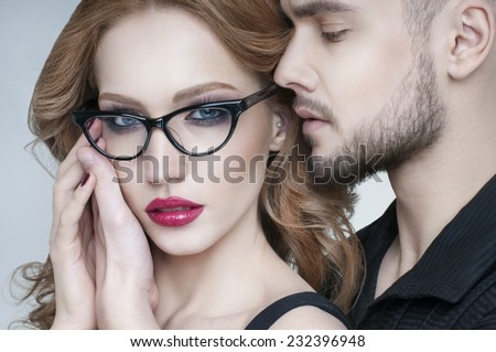 Beautiful passion couple portrait. Blond woman wearing eyeglasses. Beautiful couple in love.  Portrait of  beauty blond girl and her handsome boyfriend. Young family. Love.