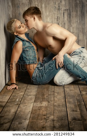 Beautiful passionate couple in love. Love concept. Jeans denim style. - stock photo