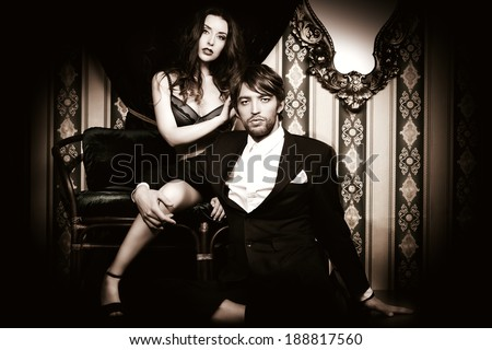Beautiful passionate couple in love. Vintage interior. - stock photo