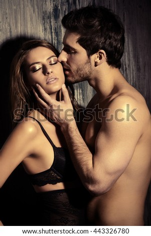 Beautiful passionate couple of young people in love. - stock photo