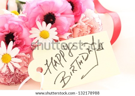 beautiful pastel color spring flower bouquet with hand written card for birthday image - stock photo