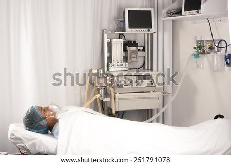 Beautiful patient receives anaesthetic in hospital - stock photo