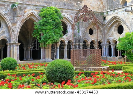 Beautiful patio and Gothic walls of Fontfroide Abbey, Languedoc-Roussillon, France - stock photo