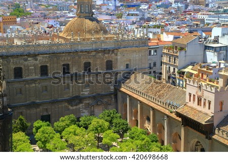 Beautiful patio with orange trees at the Cathedral of Saint Mary of the See (Seville Cathedral) in Seville, Andalusia, Spain - stock photo
