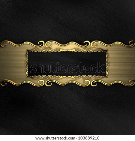 Beautiful pattern on a gold plate on a black background