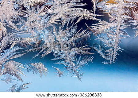 beautiful patterns are made by frost on window of house - stock photo