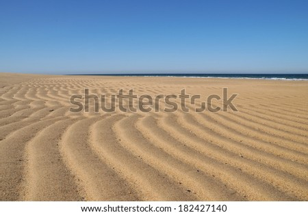 Beautiful patterns made in the sand by the outgoing tide at Race Beach on Cape Cod - stock photo