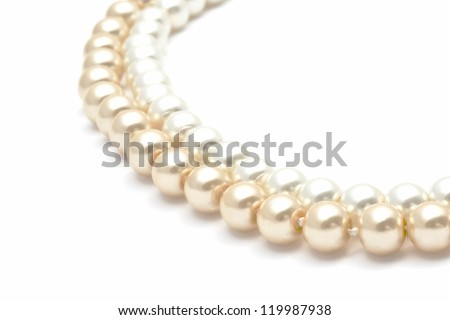 Beautiful pearl necklace closeup on white background - stock photo
