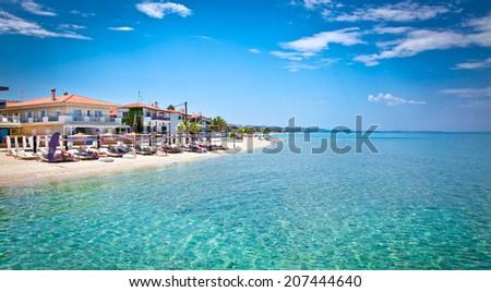 Beautiful Pefkochori beach on Kasandra peninsula, Halkidiki, Greece. - stock photo