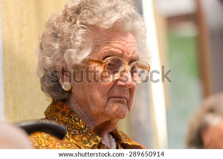 Beautiful pensioner on nature background - stock photo