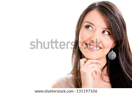 Beautiful pensive woman portrait - isolated over a white background