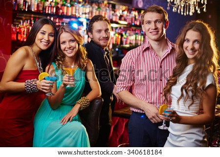 Beautiful people drinking cocktails in nightclub