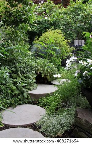 Beautiful perennial garden path in summer.  - stock photo