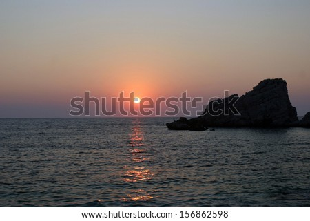 Beautiful Petanoi beach famous for it sunsets in the western side of Kefalonia island, Ionian Sea, Greece  - stock photo