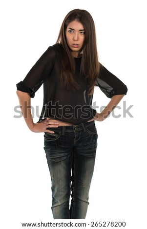Beautiful petite Eurasian woman in a black blouse and jeans - stock photo