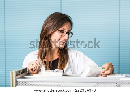 Beautiful Pharmacist Portrait in a Drugstore - stock photo