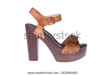 Beautiful photo of female leather sandals isolated on white background. - stock photo
