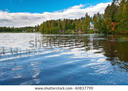 Beautiful photo of finnish lake with houses and summer cottages on the shore. - stock photo