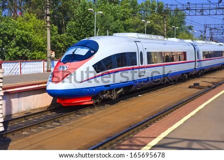 Beautiful photo of high speed modern commuter train - stock photo