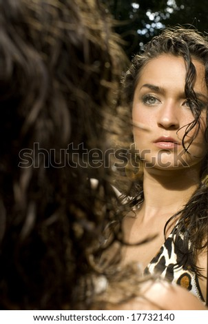 Beautiful photo of the reflection of an adult female in a print top - stock photo