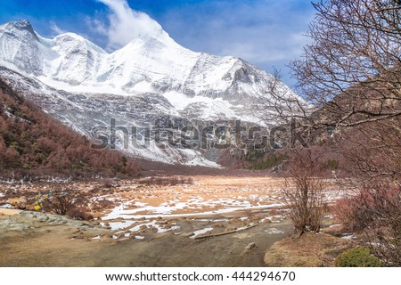 beautiful photograph capturing the rocky snow mountains in colorful china - stock photo