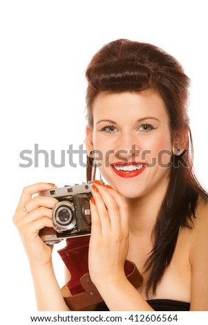 Beautiful photographer. Cute lovely retro style summer teen girl holding using vintage old camera isolated on white background - stock photo