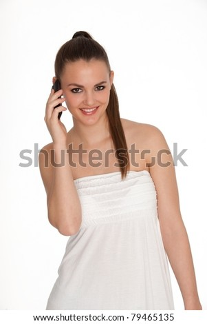 Beautiful picture of brunette who has a mobile on a white background