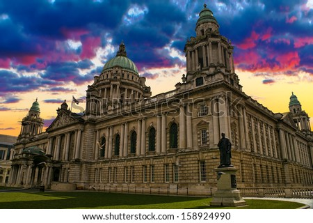 Beautiful Picture of City Hall in Belfast Northern Ireland during a colorful sunset. - stock photo