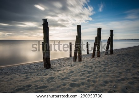Beautiful piece of old destroyed pier in Gdynia, poland. Seascape with wooden molo in Orlowo.  - stock photo