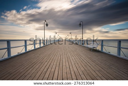 Beautiful pier in Gdynia, poland. Seascape with wooden molo in Orlowo. Landscape photographed before sunrise - stock photo