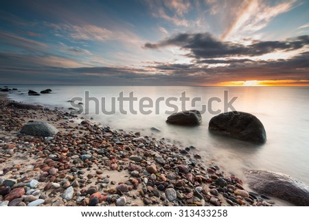 Beautiful pier in Gdynia, poland. Seascape with wooden molo in Orlowo. Landscape with long exposure effect - stock photo