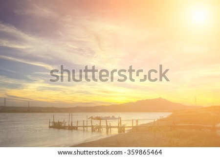 Beautiful pier scenery with dramatic clouds in sky in Taipei city, Taiwan. - stock photo