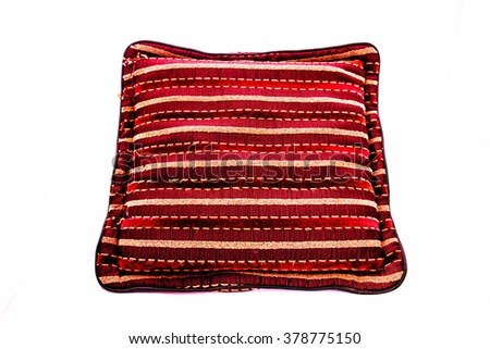 Beautiful pillow on a white background, closeup