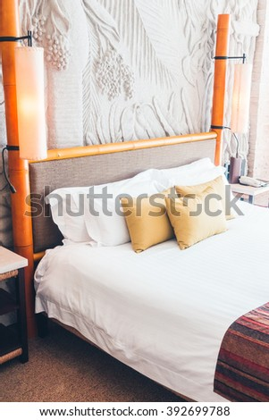 Beautiful pillow on luxury bed in bedroom interior - Vintage Light Filter
