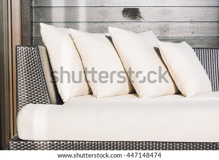 Beautiful pillow on sofa decoration at outdoor patio - Vintage light Filter