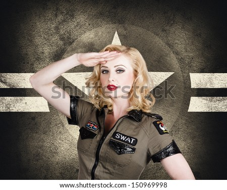Beautiful pin-up girl in classic military uniform posing a salute with wavy short blond hair style on grunge star background.  Vintage and retro fashion style  - stock photo