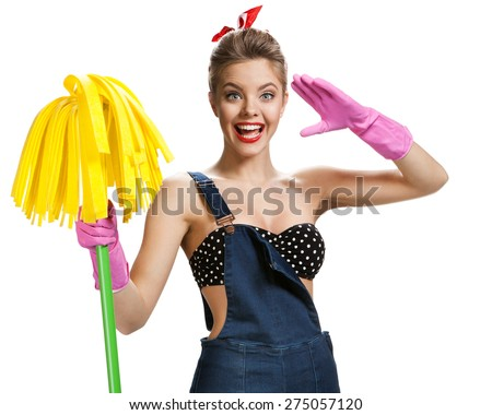 Beautiful pin-up girl wearing pink rubber protective gloves holding cleaning mop / young beautiful American pin-up girl isolated on white background. Cleaning service concept - stock photo
