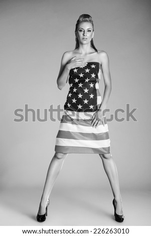 Beautiful pin-up style fashion model in dress made from american flag - stock photo