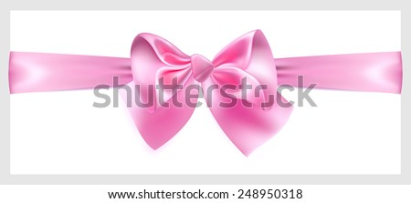 Beautiful pink bow with ribbon made of silk, located horizontally - stock photo