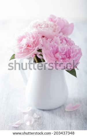 beautiful pink peony bouquet in vase  - stock photo