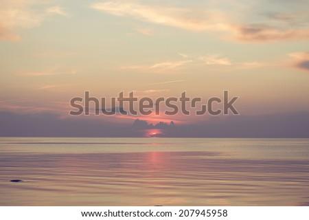 Beautiful pink purple mild sunset on the estonian beach - stock photo