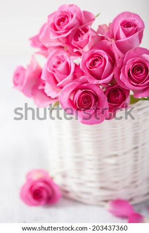 beautiful pink roses bouquet in basket  - stock photo