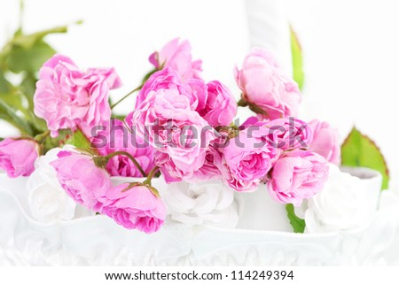 Beautiful pink roses in wedding basket